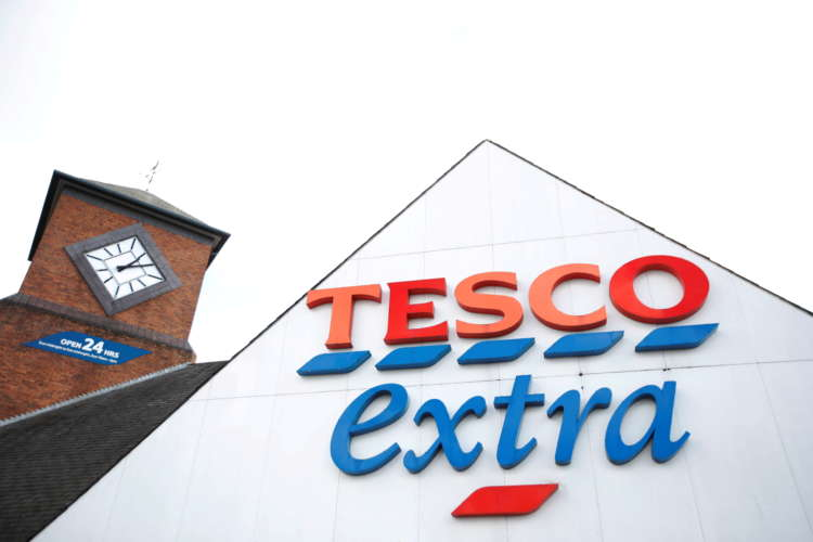 Britain's Tesco concedes to activist shareholders on health targets