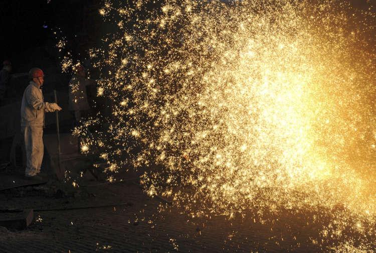 China's factory output slows as bottlenecks crimp production