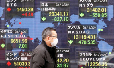 Asian share markets edge higher on pandemic recovery signals
