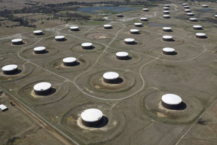 Oil edges up but set for weekly fall on Iran crude talks