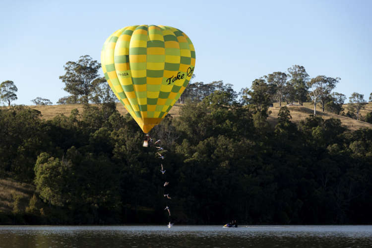 Iffland dives from moving hot air balloon in Australia