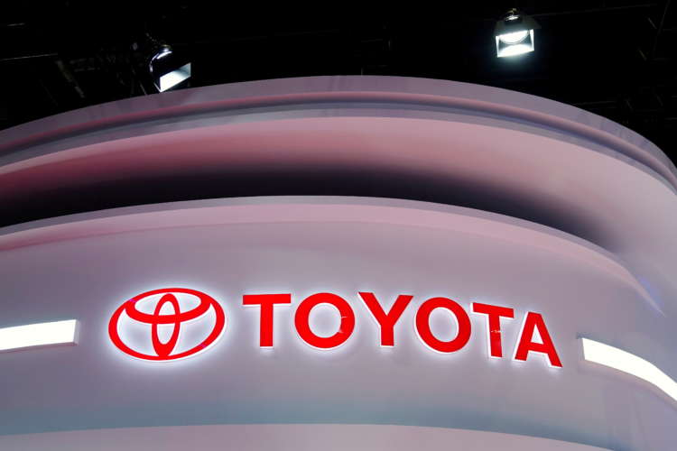 Toyota Motor shares gain for third day, hit record high