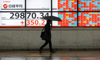 Stocks gain as investors eye economic recovery, gold shines