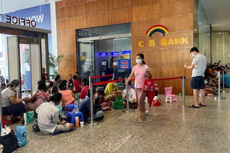 Lines, tokens and money brokers Myanmar's crumbling economy runs low on cash