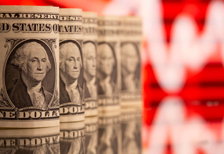 Dollar holds gains as traders look to U.S. data for policy cues