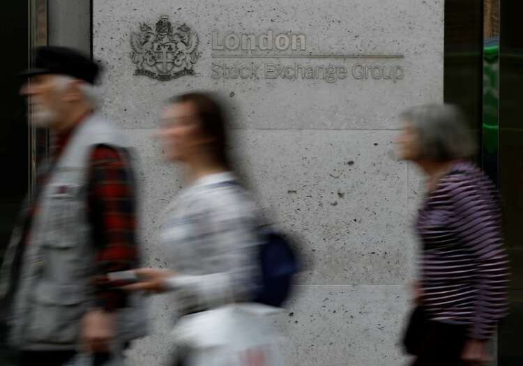 Consumer staples, industrial stocks boost FTSE 100; delayed reopening cap gains