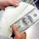 U.S. dollar little changed following Fed minutes 14