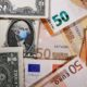 U.S. dollar falls as euro climbs in risky FX rout 22