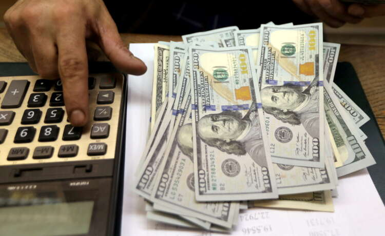 Dollar rises but still set for biggest weekly loss since May 1