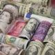 Dollar sluggish as traders bide time before Fed meeting; kiwi jumps 17
