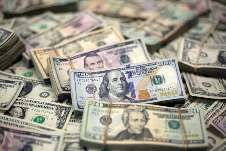 Dollar wallows near one-week low as haven demand ebbs 1