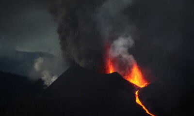 Hundreds evacuated as red-hot lava threatens homes in Spain's La Palma 19