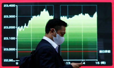 Asian shares advance on earnings optimism, yen slips to 4-yr low 1